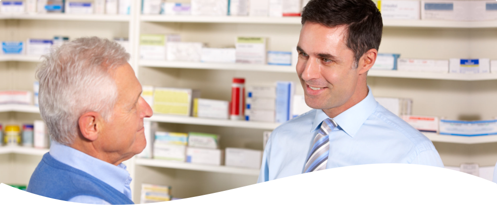 pharmacist with customer smiling